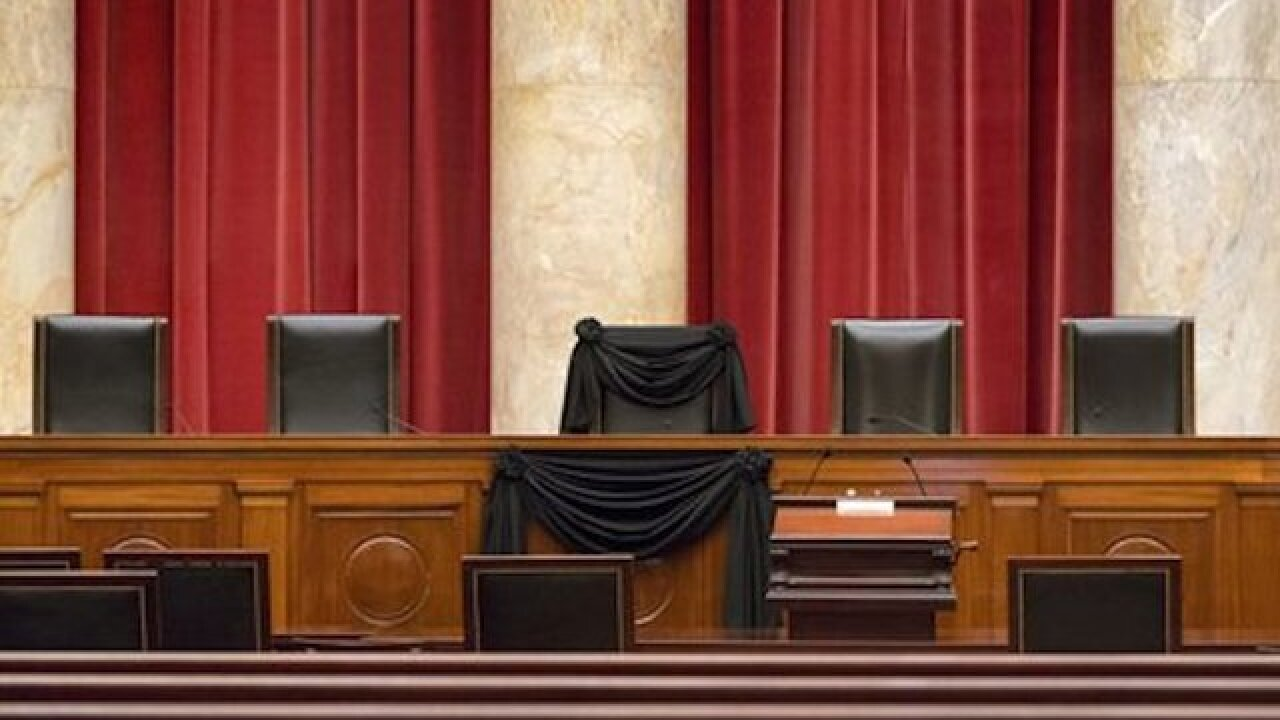 Scalia's Supreme Court chair draped in black