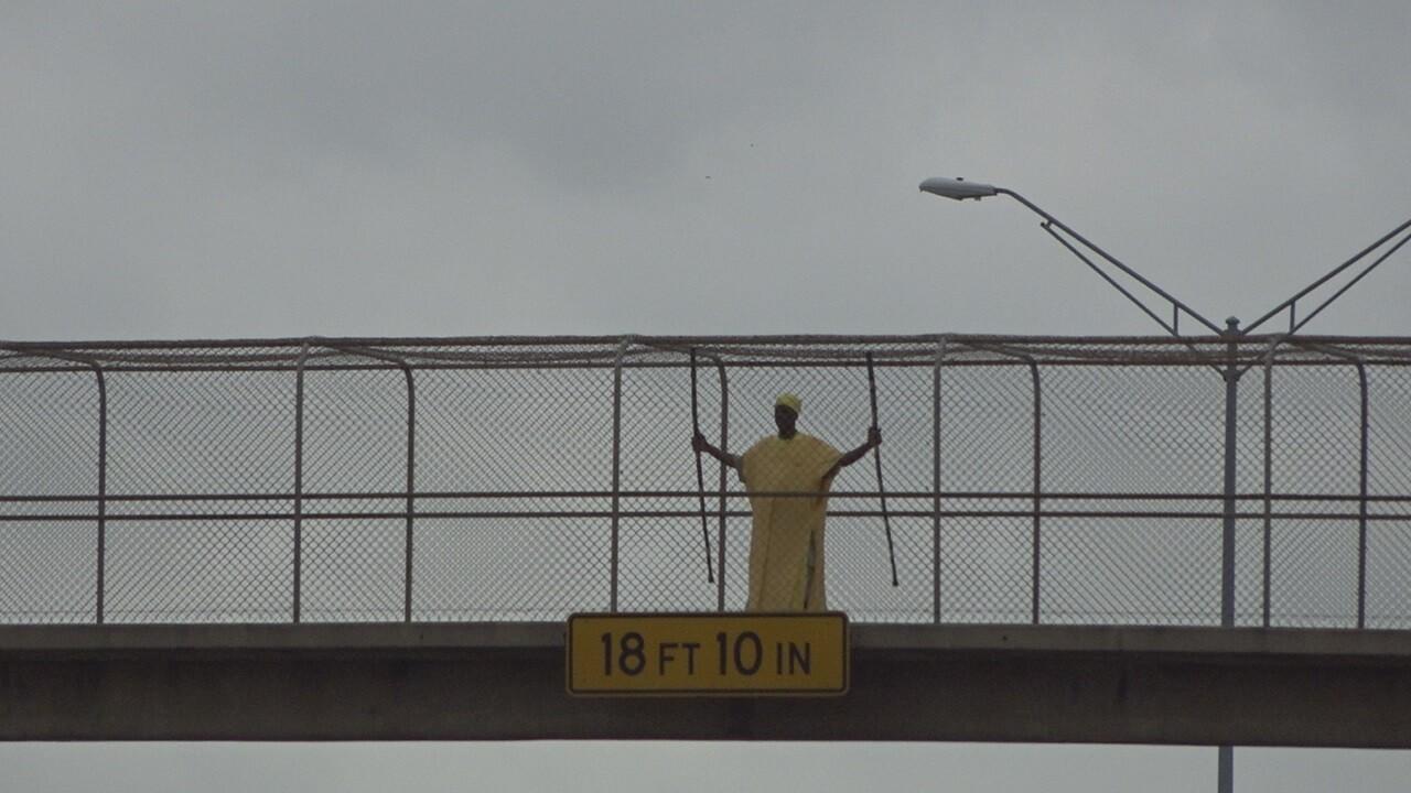 Praying man reacts to bridge demolition