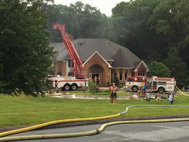Firefighter dies battling massive house fire