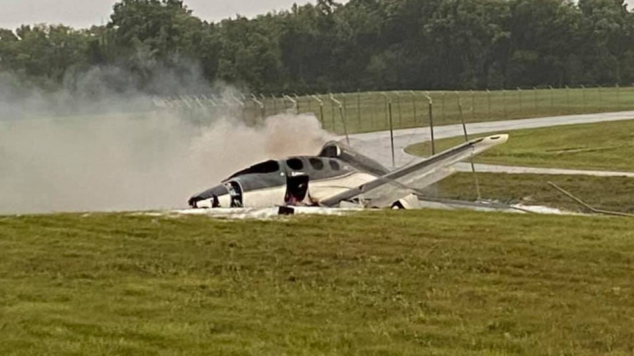 A small plane on fire at Capitol Region International Airport