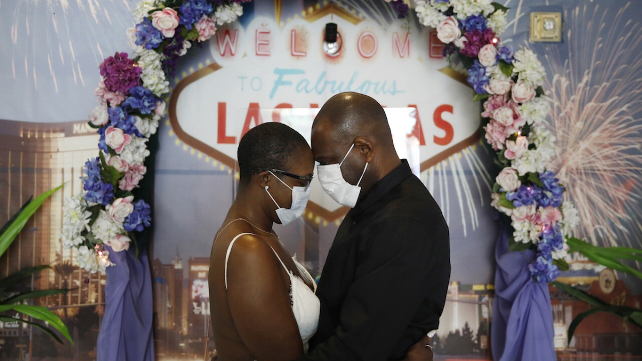 Using face masks and sanitizer, couples say 'I do' in Vegas