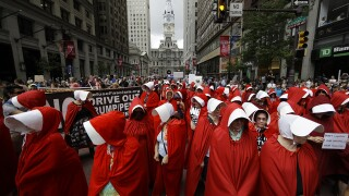 Protesters dress as 'Handmaid's Tale' characters to protest VP Mike Pence