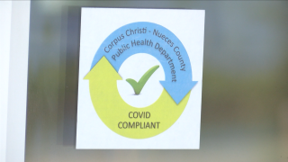 Stickers signify COVID-19 compliant restaurants