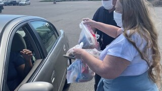 Volunteers deliver food to families in Cherry Creek School