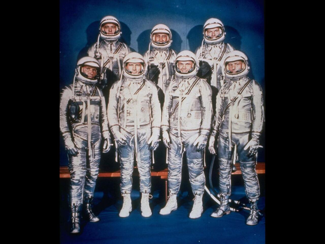 Mercury 7 astronauts: (l-r front) Walter Schirra, Donald Slayton, John Glenn, and Scott Carpenter; (back) Alan Shepard, Virgil Grissom, and Gordon Cooper, photo on black