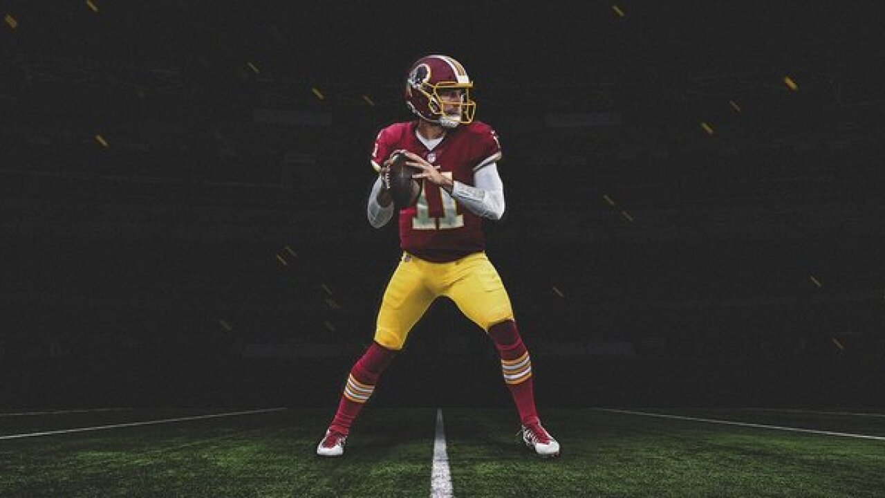 Alex Smith officially traded to Washington