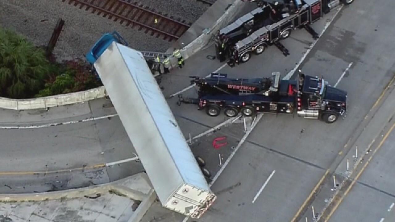 Semi dangles from ramp in Florida