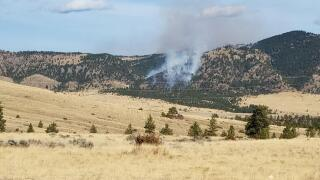 Firefighters battle fire near Gates of the Mountains
