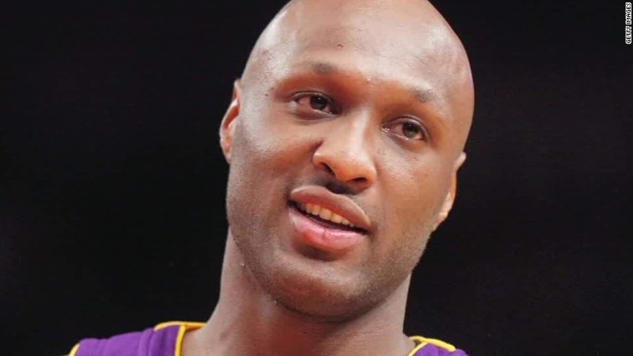 Ex-coach says Lamar Odom breathing on his own, reveals what he told Khloe Kardashian