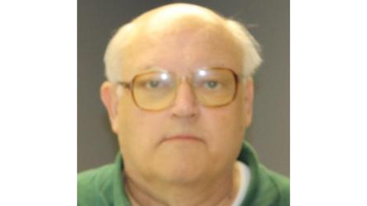 Okemos priest heading to trial on embezzlement charges