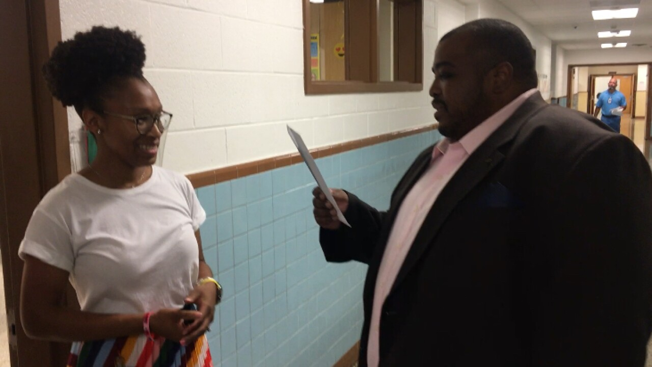 Portsmouth School Board member returns to former elementary school, surprises teachers with money for supplies