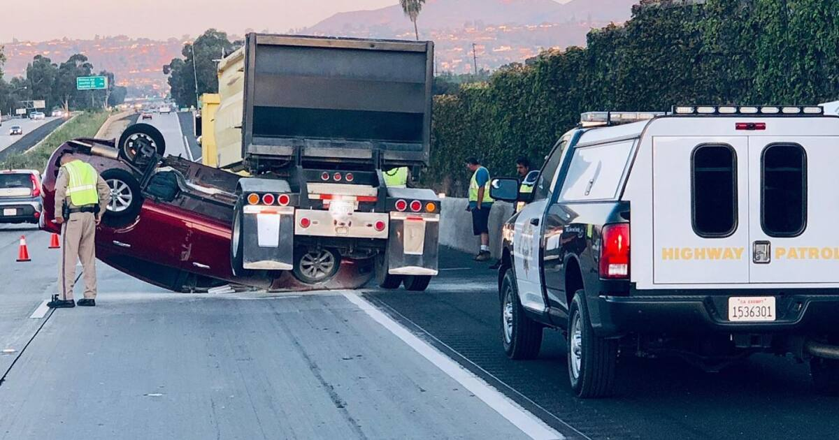 Woman wedged under semi on I-8 suspected of DUI