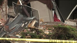 Car hits apartment building in Kentwood