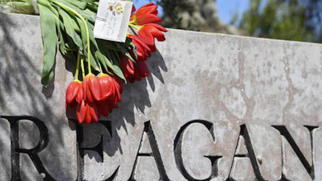 Mourners leave flowers at Reagan Library