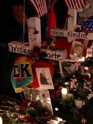 58 white crosses honor mass shooting victims