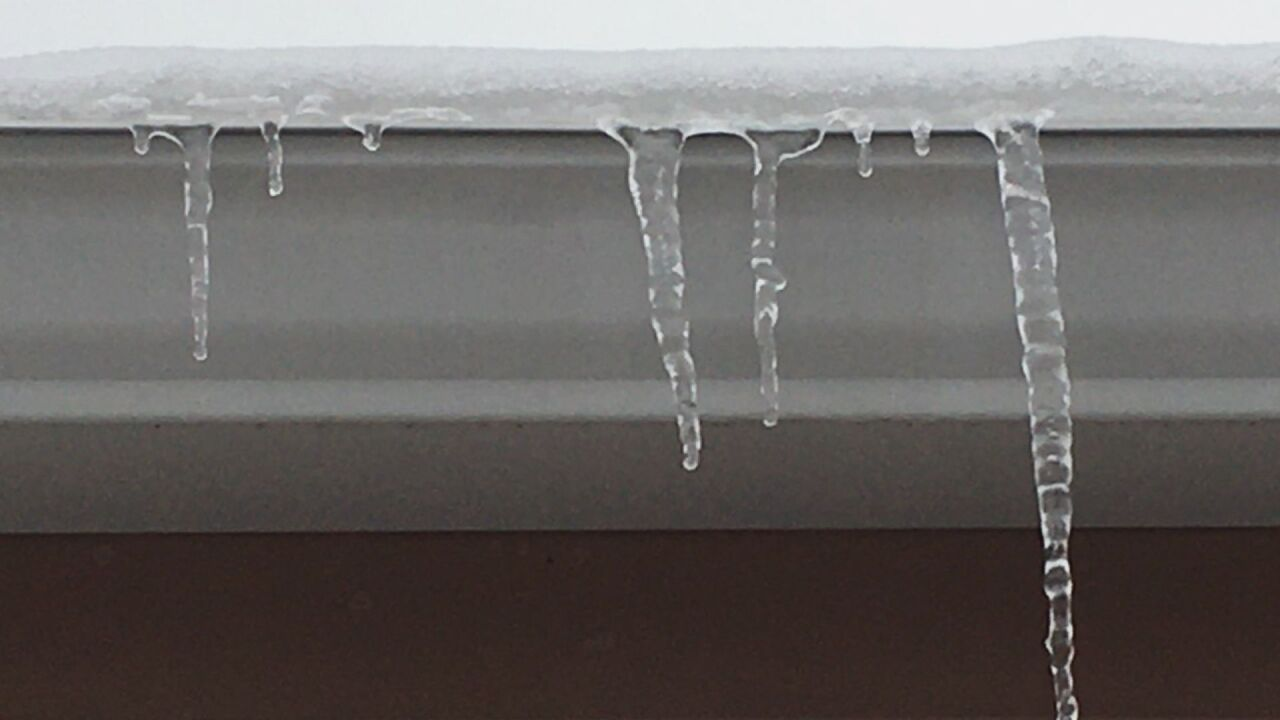 Ice forms over David Cozad's gutters