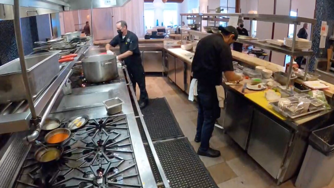 Workers inside the kitchen at the Palm Beach Marriott Singer Island Beach Resort and Spa