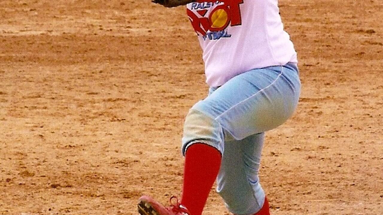 Olivia playing softball