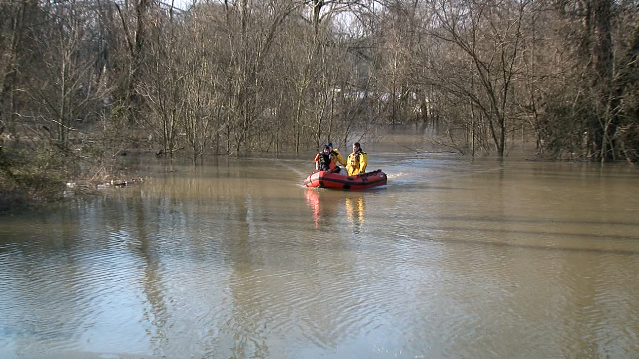 Happy ending: Cincinnati firefighters rescue a dog swept away by floodwaters