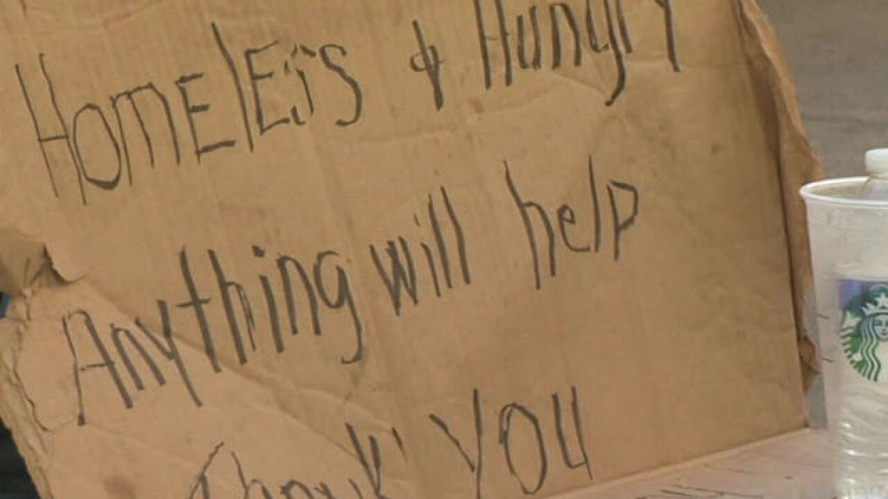 Signs warning against panhandlers stolen