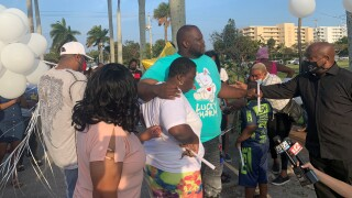 The Riviera Beach community came together Sunday night to remember the life of a 7-year-old boy who was shot and killed while sleeping inside his home last week.