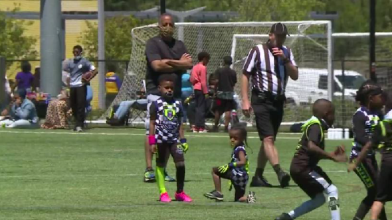 Youth football coach combines his love for the sport and his community through fundraising