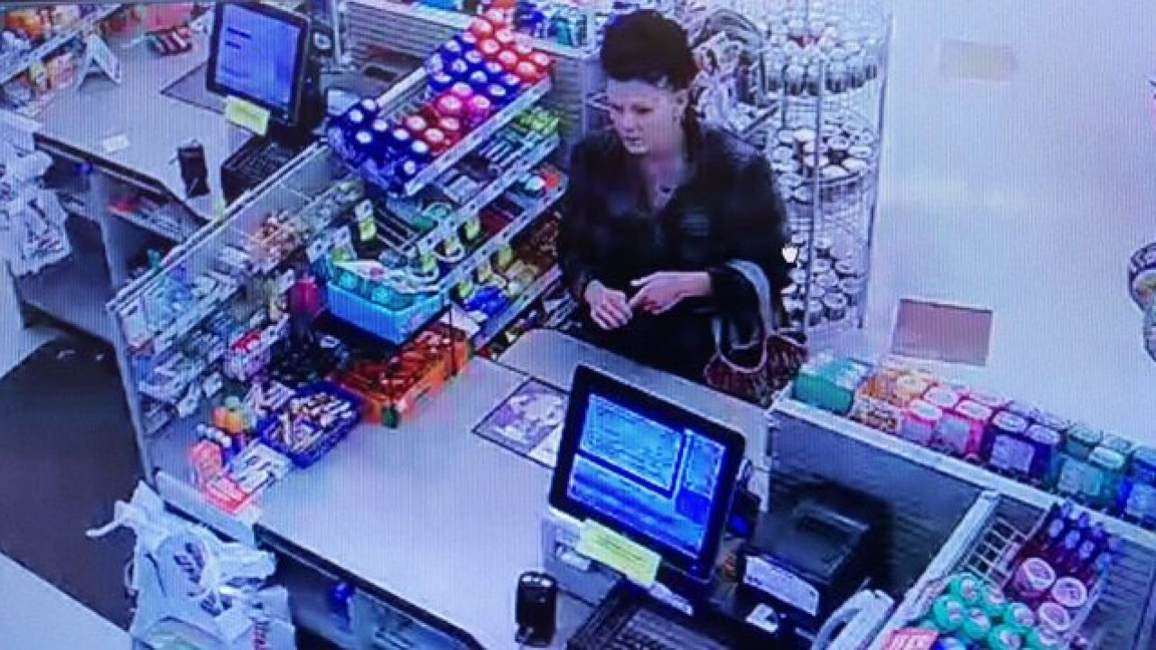 Woman on camera stealing 10 packs of cigarettes