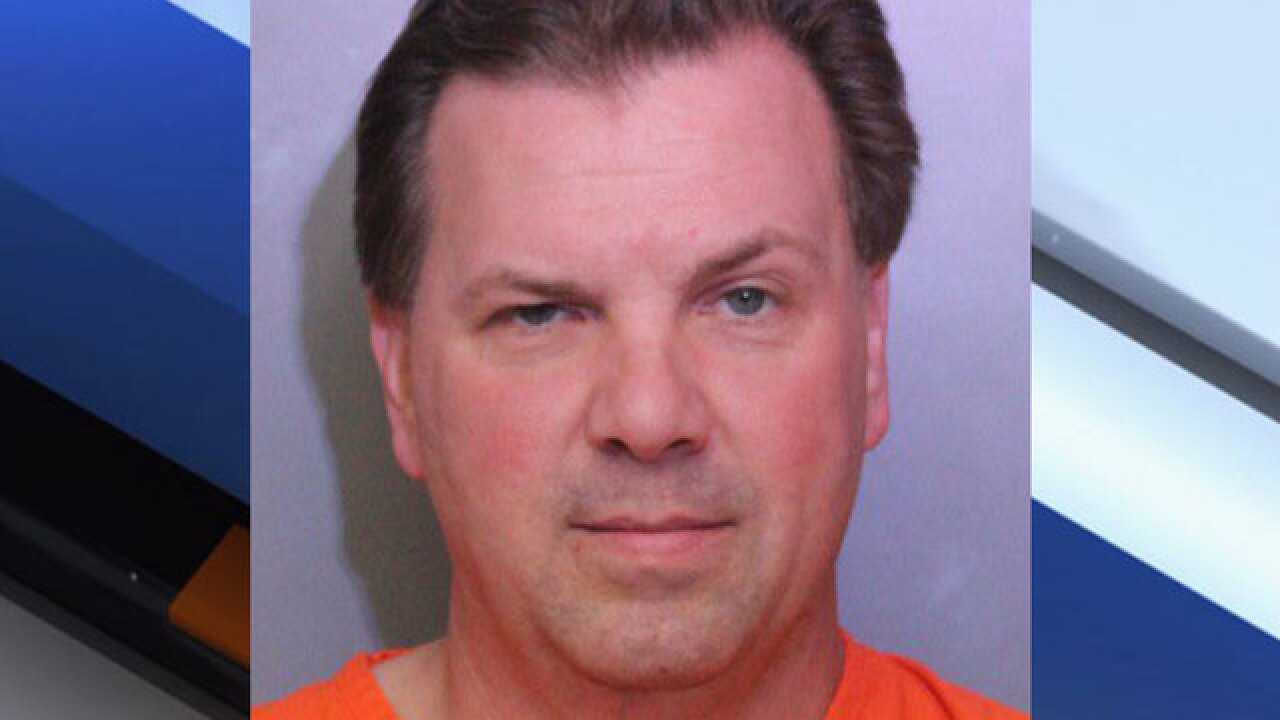 City official charged with murder in shooting