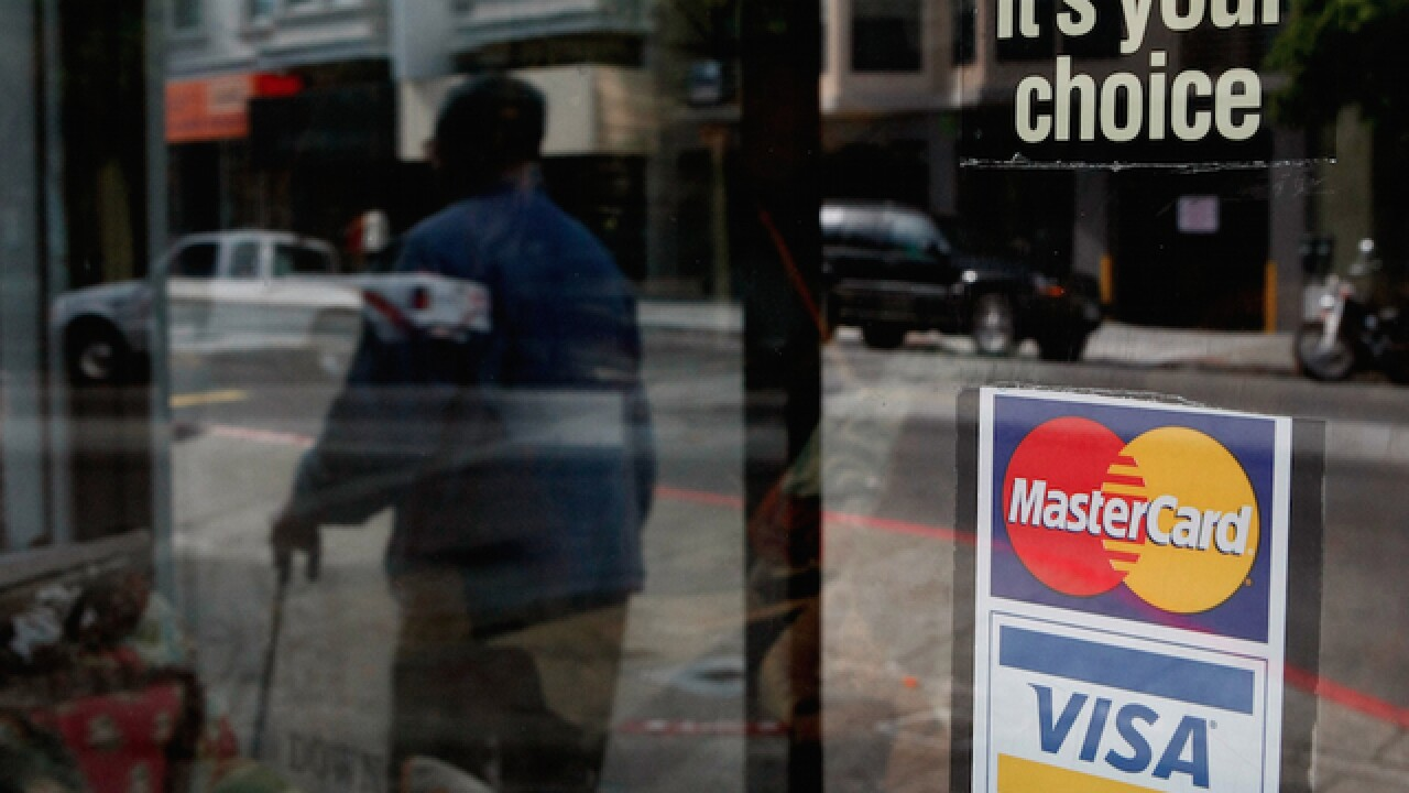 Visa says improved cards will help at checkout