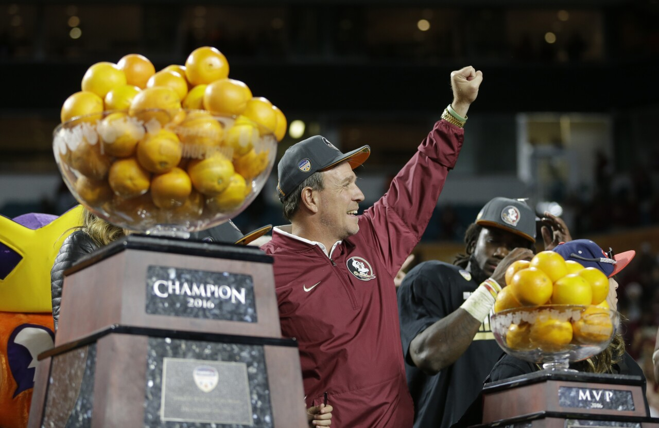 Florida State Seminoles head coach Jimbo Fisher holds fist in air after winning 2016 Orange Bowl