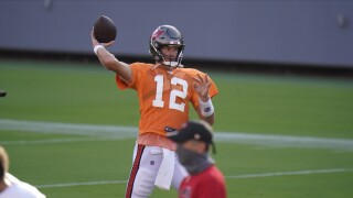 Tampa Bay Buccaneers QB Tom Brady throws during training camp, Aug. 28, 2020
