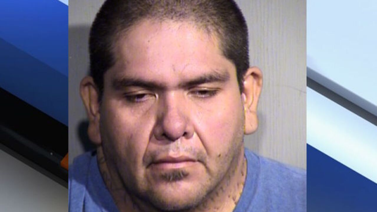 Man in custody, 21 displaced after fire at Phoenix apartment complex