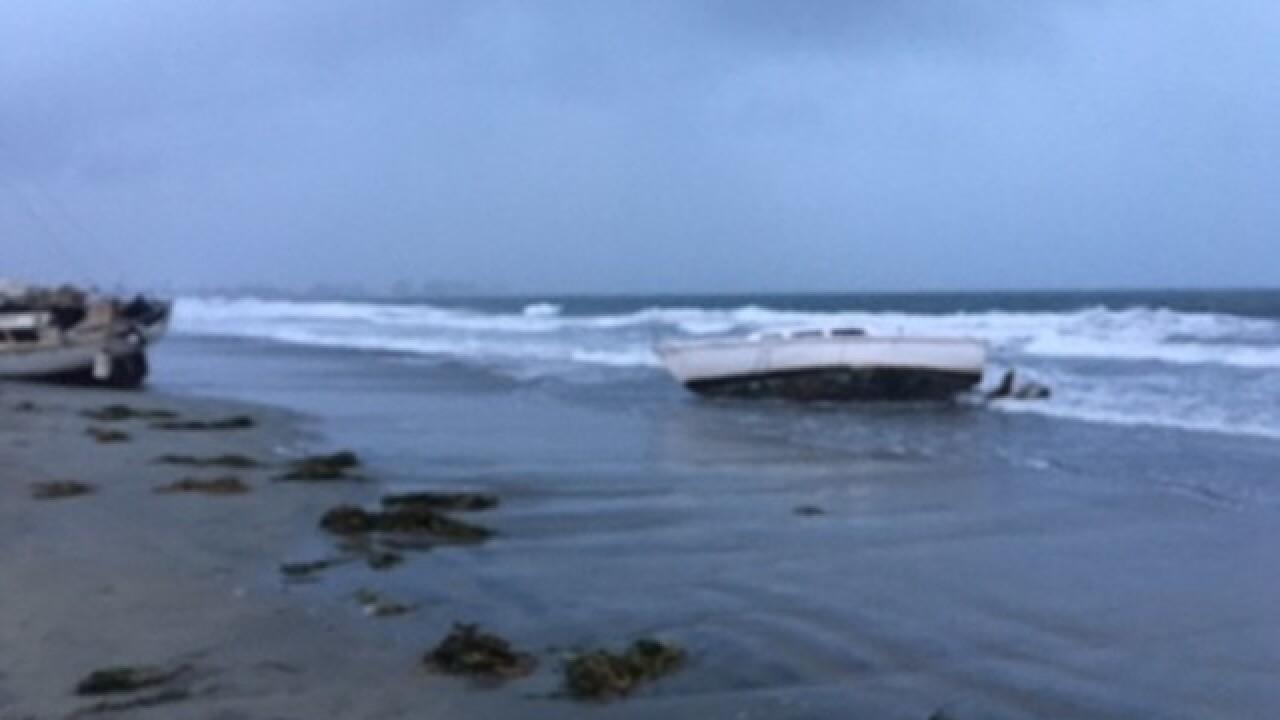 Boats left washed ashore at Naval Base Coronado