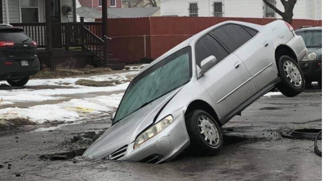 Image result for CAR FALL INTO HOLE