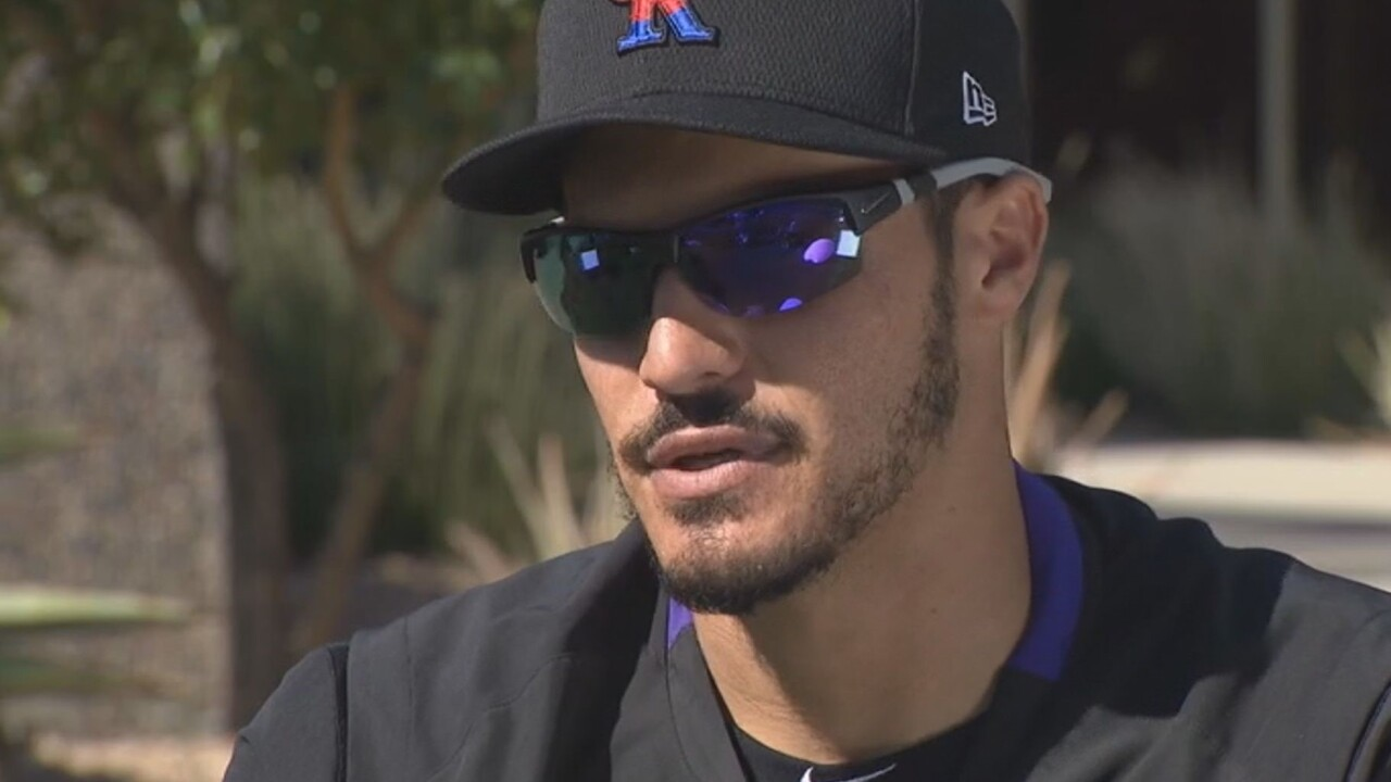 Rockies Arenado turning page to 2020