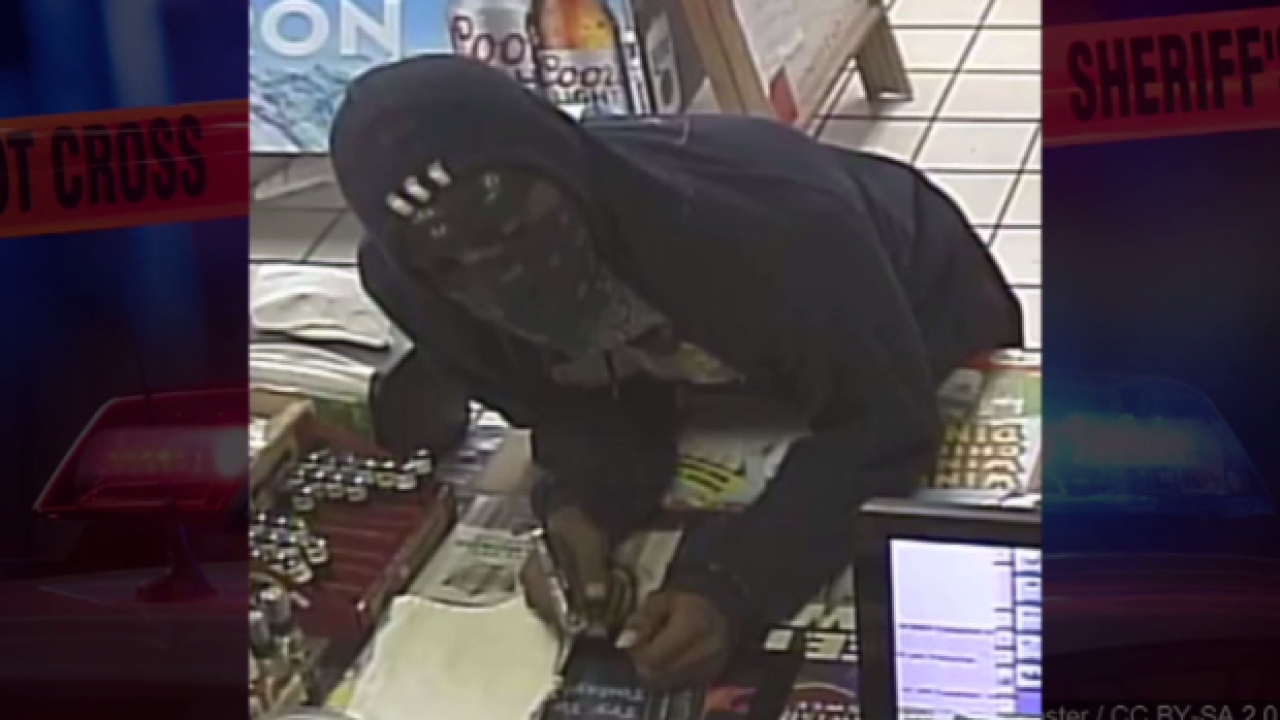 armed robbery suspect.PNG