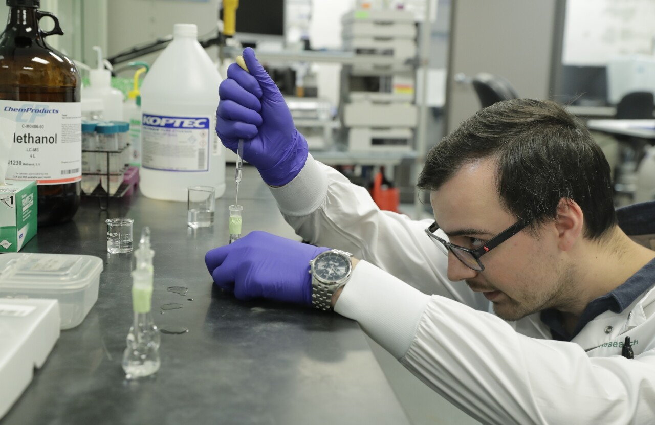 Pierce Prozy prepares a CBD vape oil test sample at Flora Research Laboratories in Grants Pass, Ore., on July 19, 2019. (AP)