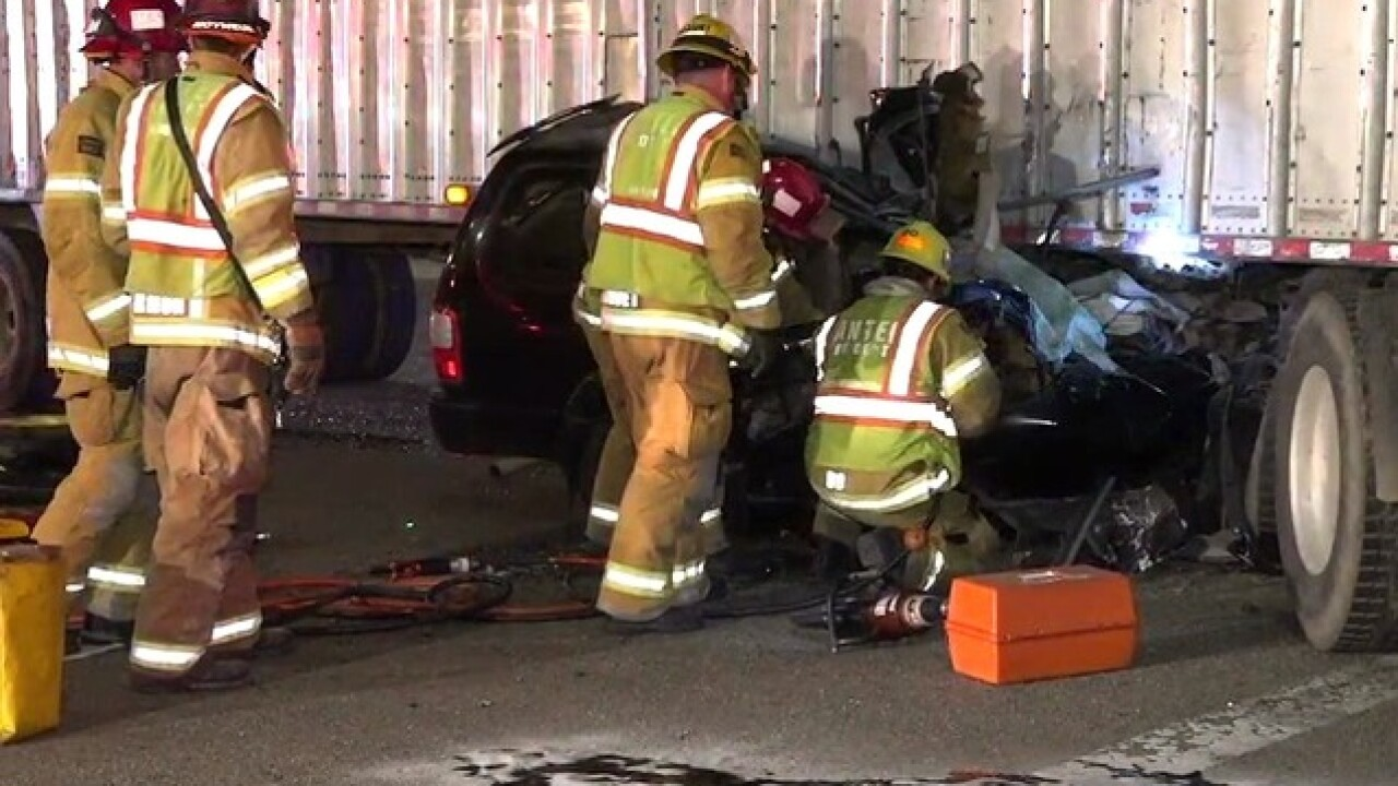 Car gets jammed under semi on SR-52, one dead