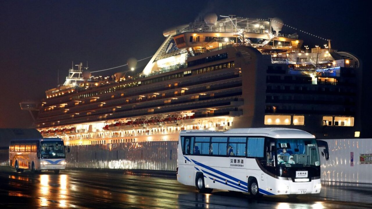 Trading quarantines, Americans from cruise land in US