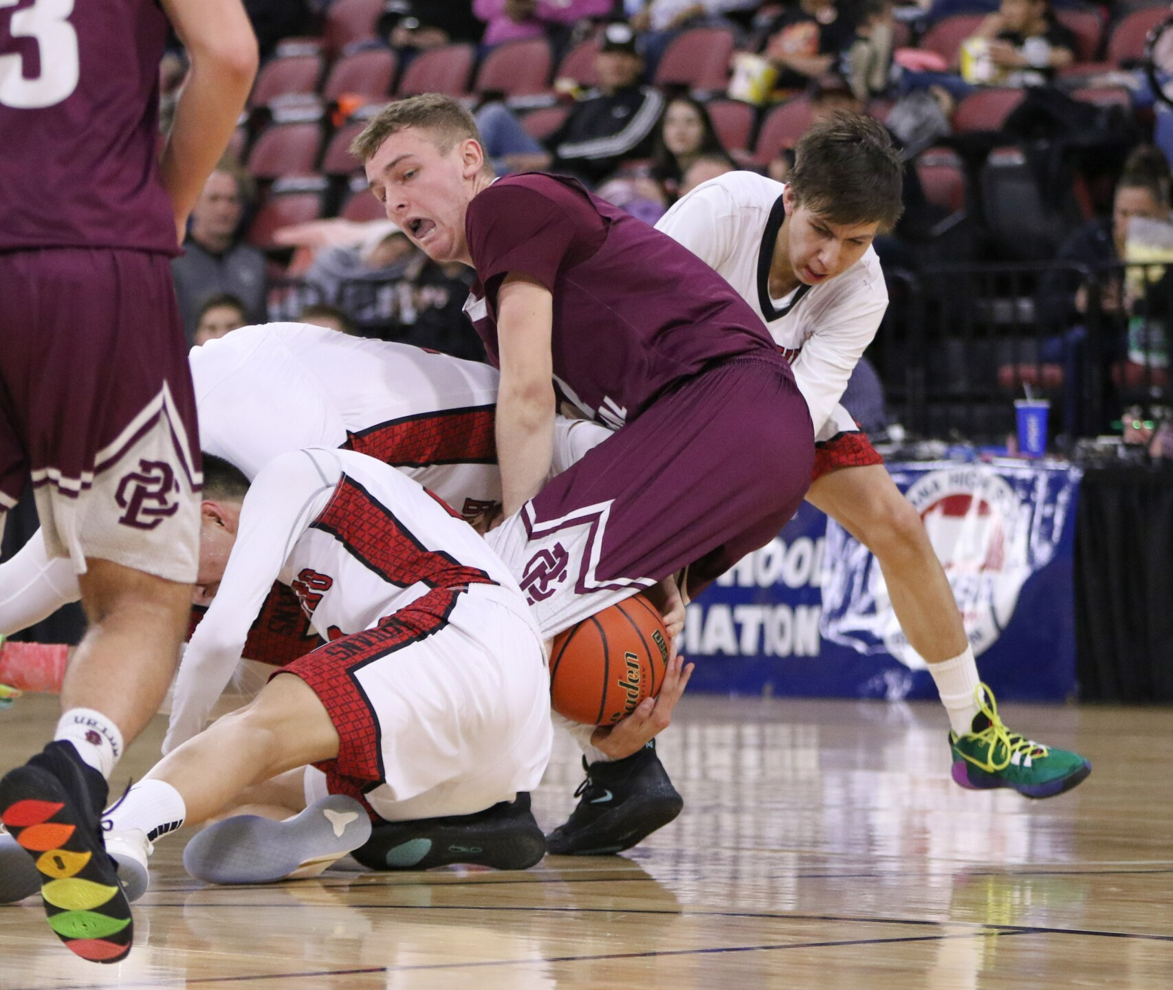 Three Browning players and Jared Simkins fight for possession of the ball.jpg