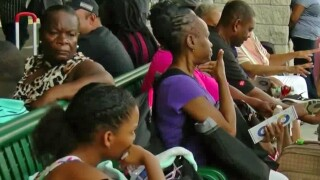 wptv-bahamas-bahamian-evacuees.jpg