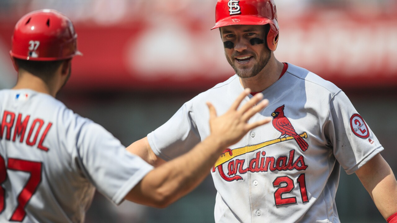 Surging Cards win 8-2 over struggling Royals
