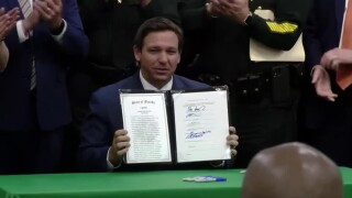 Florida Gov. Ron DeSantis signs the 'anti-riot' bill into law on April 19, 2021.jpg