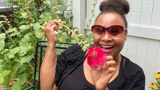 Jessica-Ann-Tyson-holding-garden-flower.jpg
