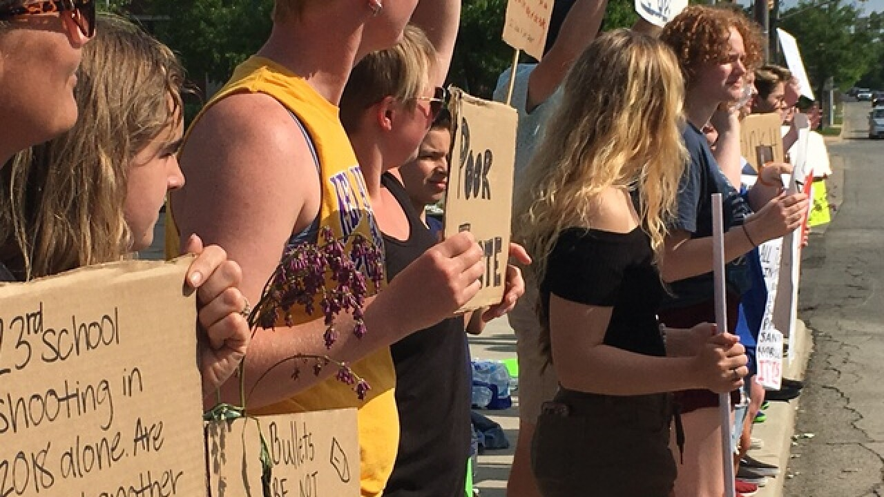 Noblesville students, parents protest outside NRA tent