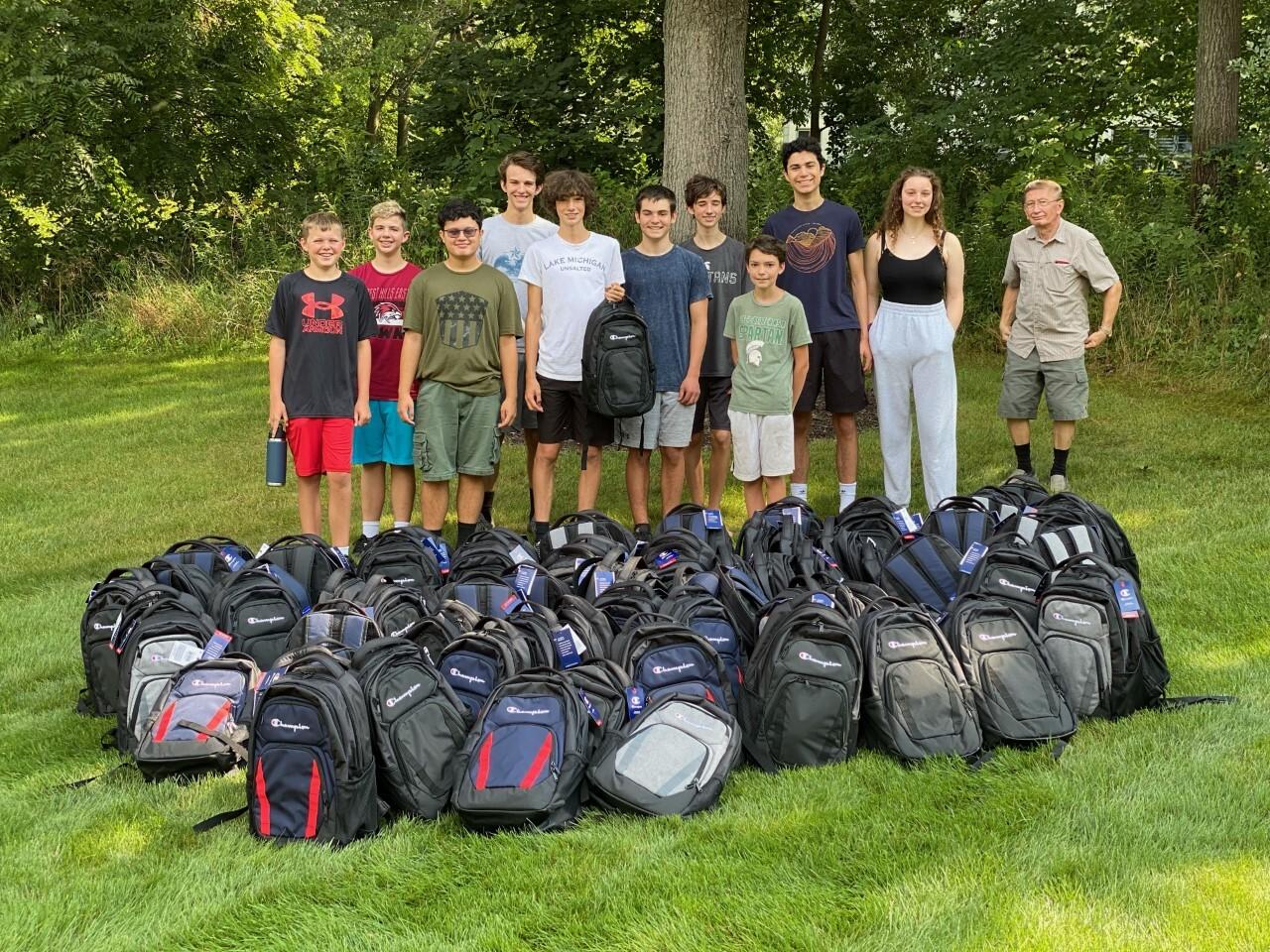 Gracin w backpacks and troop.jpg