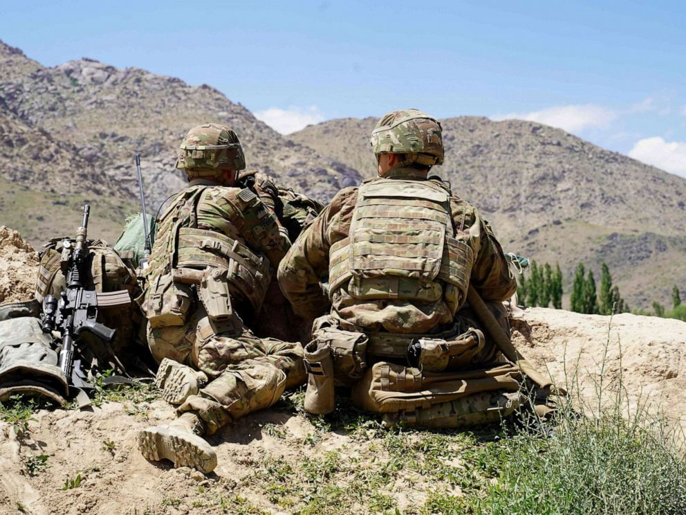 In this photo taken on June 6, 2019, U.S. soldiers look out over hillsides during a visit of the commander of U.S. and NATO forces in Afghanistan Gen. Scott Miller at the Afghan National Army (ANA) checkpoint in Nerkh district of Wardak province (Thomas Watkins/AFP/Getty Images).