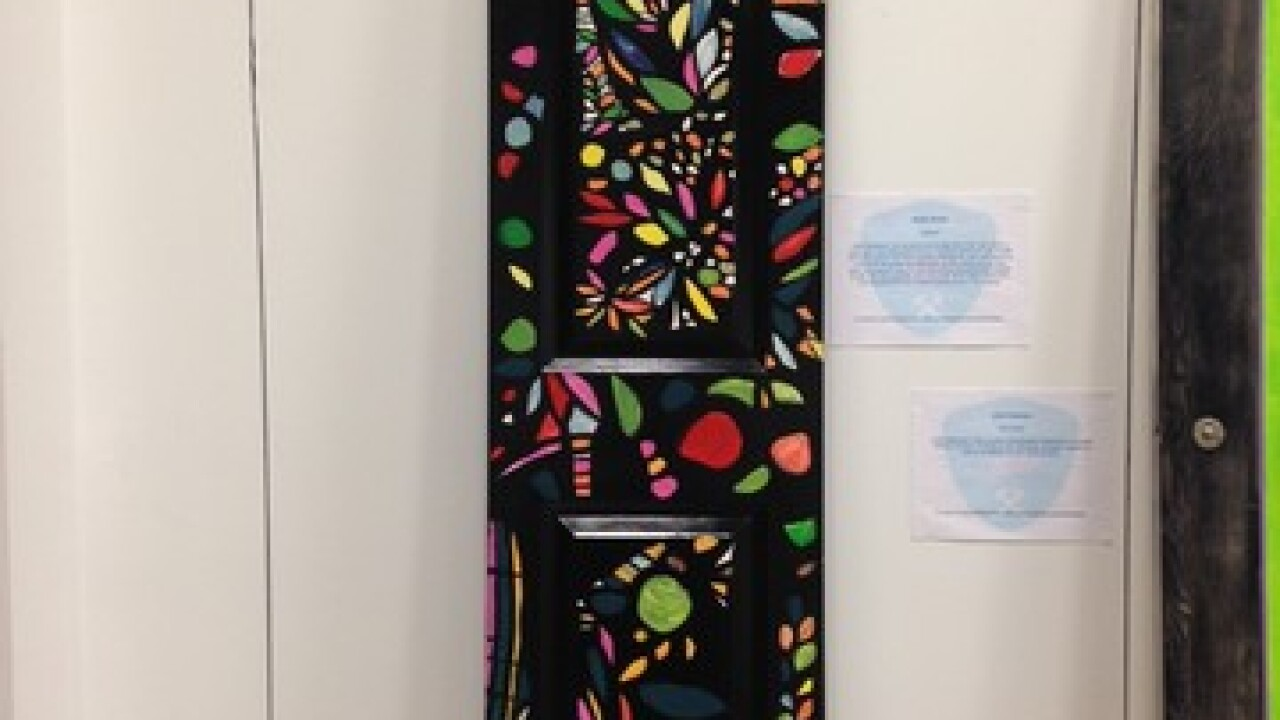 GALLERY: Artists design doors for a good cause