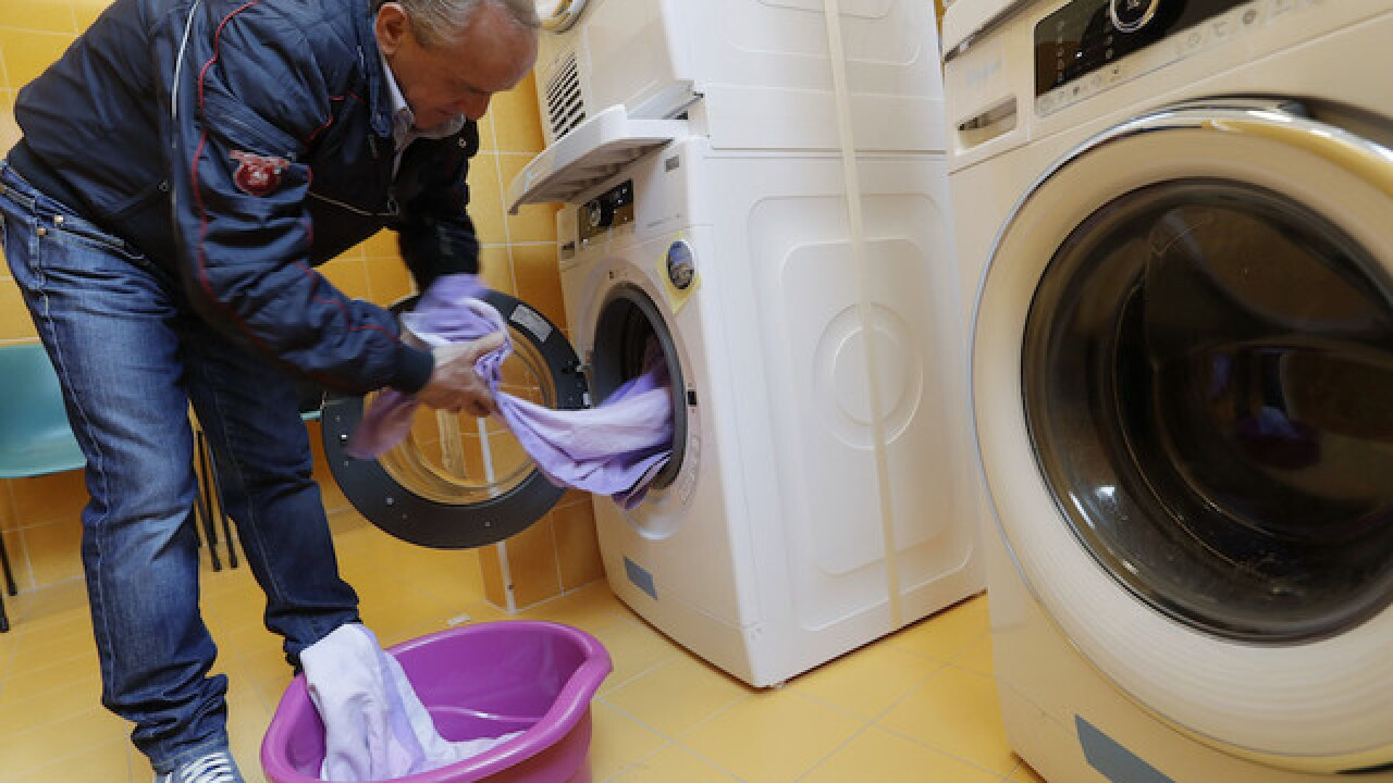 Pope Francis opens free laundromat for homeless people