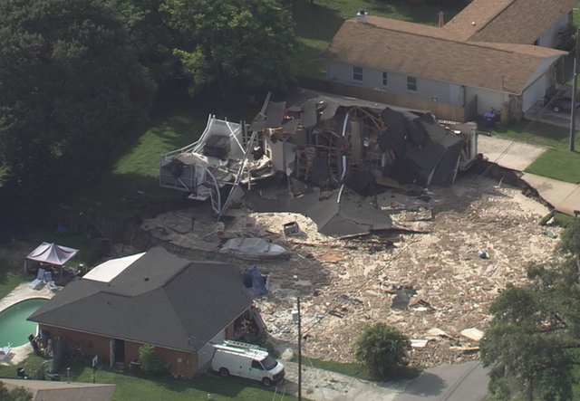 PHOTOS | Large sinkhole forms in Land O' Lakes neighborhood, homes evacuated